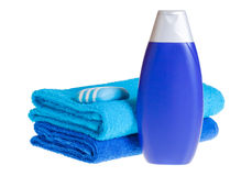 Blue terry towels, shampoo and soap Royalty Free Stock Photos