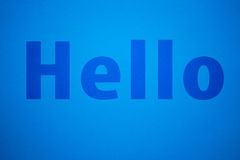 Blue text on blue paper background Royalty Free Stock Image