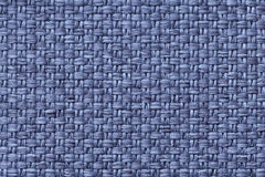 Blue textile background with checkered pattern, closeup. Structure of the fabric macro. Royalty Free Stock Images