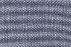 Blue textile background with checkered pattern, closeup. Structure of the fabric macro. Stock Photos