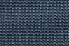 Blue textile background with checkered pattern, closeup. Structure of the fabric macro. Navy blue background with checkered pattern, closeup. Structure of the Royalty Free Stock Photography