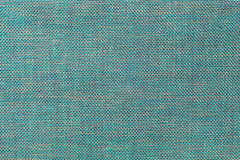 Blue textile background with chess pattern, closeup. Structure of the fabric macro. Blue background with checkered pattern, closeup. Structure of the turquoise Stock Photos