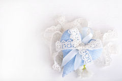Blue textile heart with a  bow from lace Stock Images