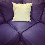 Blue textile sofa with white cushion Stock Photo