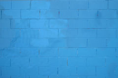 Blue texture. Blue brick wall background made of grungy rusty blocks. Stock Image
