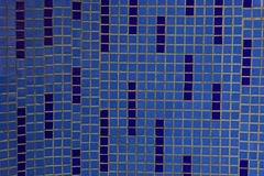 Blue texture of ceramic square tiles on a fragment of the wall stock image
