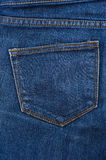 Blue texture of jeans, stitching on the pants closeup Royalty Free Stock Images