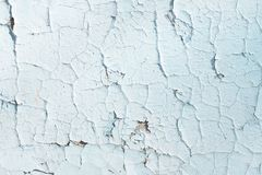 Blue texture with scratches and cracks. blue background. blue and white pattern. Light wall stock photography