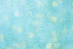 A blue textured background. An abstract rough textured background in blue and white bokeh with floating bubbles Royalty Free Stock Image