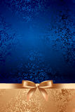 Blue textured background with gold bow Stock Photos