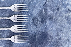 Blue textured background with silver forks Royalty Free Stock Image