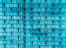 Blue textured background. Of stacked plastic blocks, with some moisture on it stock photo