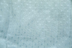 Blue Textured Cloth. With small diamond shapes woven into it Royalty Free Stock Image