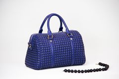 Fashionable women bag. Blue textured fashionable women bag Stock Image