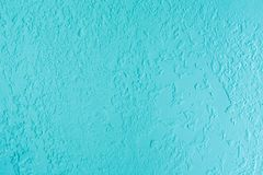 Blue textured plastered wall. Fresh otvetka in commercial premises, designer renovation in the house.  stock photos