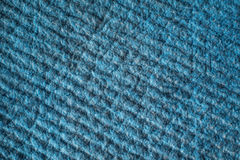 Blue textured tissue background. The pattern on the fabric surface. Pile on a dense and warm material.  Stock Image