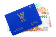 Blue Thai Work Permit book with different Thai Baht inside isola Stock Photo