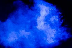 Blue theatrical smoke on stage during a performance or show.  Stock Photo