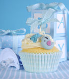 Blue theme baby boy cupcake with cute birds. And ribbon close up for baby shower or new born nursery concept royalty free stock photo