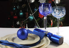 Blue theme Christmas table setting in front of Christmas Tree Royalty Free Stock Photos