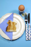 Blue theme Happy Easter breakfast table with bunny rabbit toast -Vertical Royalty Free Stock Photo