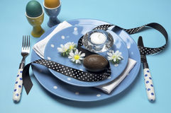 Blue theme Happy Easter dinner table setting with blue polka dot plates Royalty Free Stock Photo