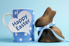 Blue theme Happy Easter polka dot breakfast coffee mug with chocolate bunny rabbit. Blue theme polka dot breakfast coffee mug with chocolate bunny rabbit and Royalty Free Stock Images