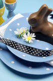 Blue theme Happy Easter table setting with bunny Stock Photography