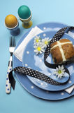 Blue theme Happy Easter table setting - vertical aerial view. Royalty Free Stock Photo