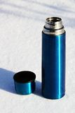Blue thermos with a cup Royalty Free Stock Photos
