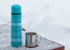 Blue thermos and tourist mug Stock Photography