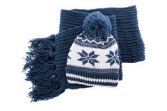 Blue thick warm winter knitted ski hat and scarf isolated on white background Royalty Free Stock Photos