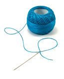 Blue thread ball and needle Royalty Free Stock Photos