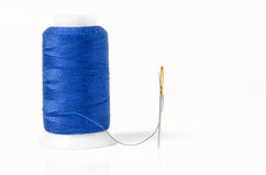 Blue thread with needle Royalty Free Stock Photos