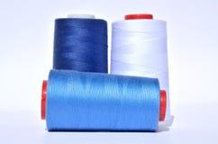 Blue thread reels Stock Photos