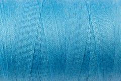 Blue thread texture. Close-up of a blue thread texture royalty free stock photos
