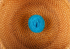 Blue thread on a yellow background wicker Stock Images