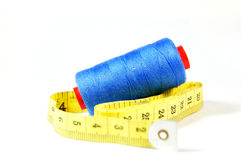 Blue threads with measuring tape. On white background Royalty Free Stock Images