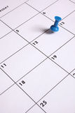 Blue Thumb Tack on Calendar Stock Image