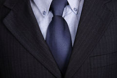 Blue tie. Detail of a Business man Suit with blue tie Royalty Free Stock Image