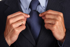 Blue tie. Detail of a Business man Suit with blue tie Royalty Free Stock Photos