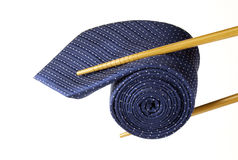 Blue tie and chopsticks Royalty Free Stock Photos
