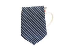 Blue tie and coffee mug Royalty Free Stock Image