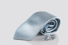 Blue tie with cuff links. On white background Royalty Free Stock Photos