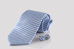 Blue tie with cuff links Royalty Free Stock Photos