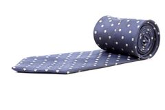 Blue tie with white speck. Isolated on a white background Stock Images