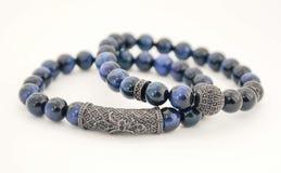 Blue tiger eye gemstone bracelet silver. Healing gemstones photograph stock photography