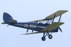 A blue Tiger Moth airplane in the air royalty free stock photo