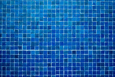 Blue tile background. Small square blue tiles on a wall Royalty Free Stock Photography