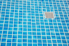 Blue tile on bottom of a swimming pool Stock Photography